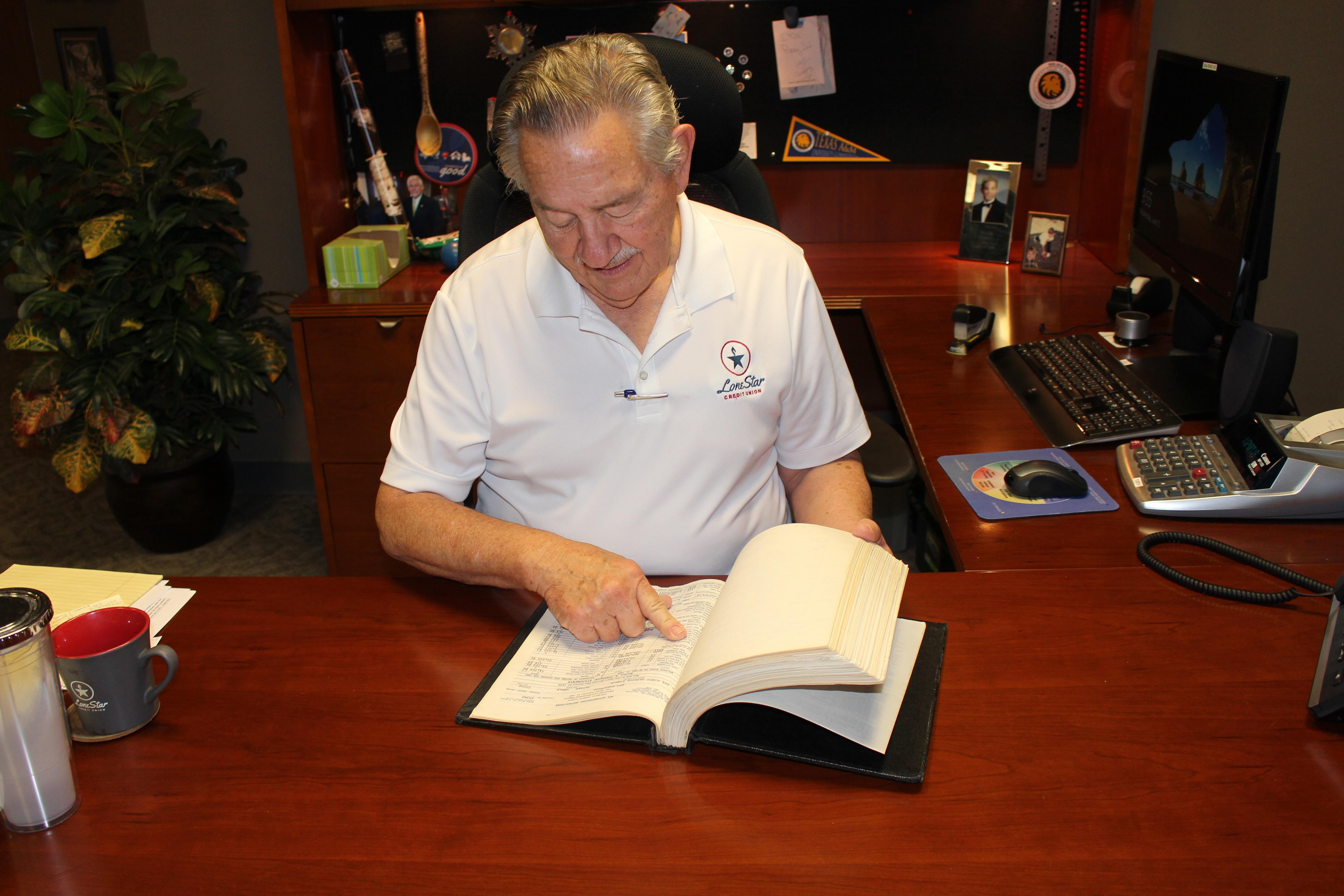 Man reading a book at a desk